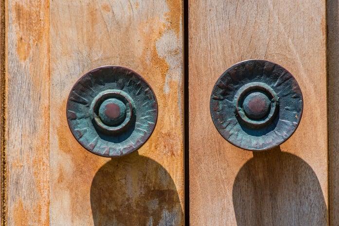 Colourful door knobs patina